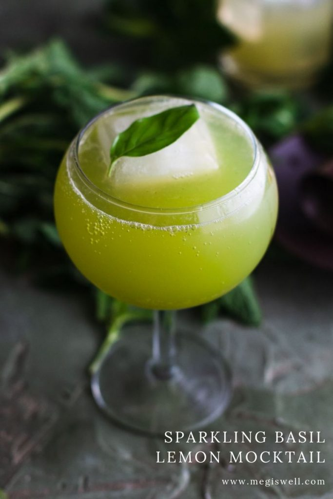 This Sparkling Basil Lemon Mocktail has flavors of basil, cardamom, lemon, and mint that will leave you with a fresh sparkle. | Non Alcoholic | Summer Drinks | Shrub Mocktail | #mocktail #megiswell #meganwellsphotography | www.megiswell.com