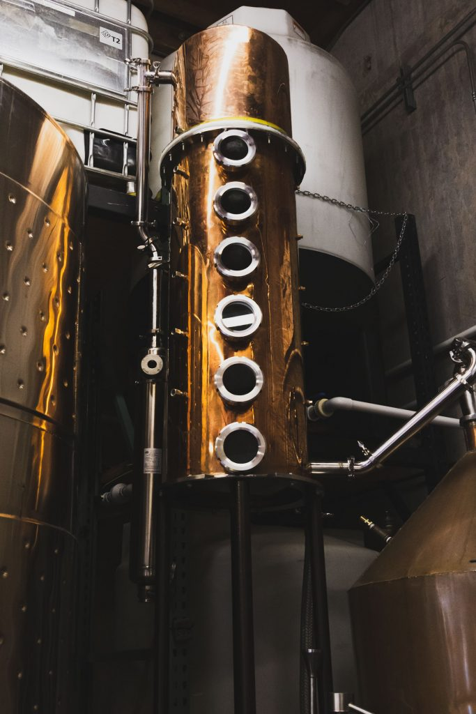 Vertical shot of distillery still.