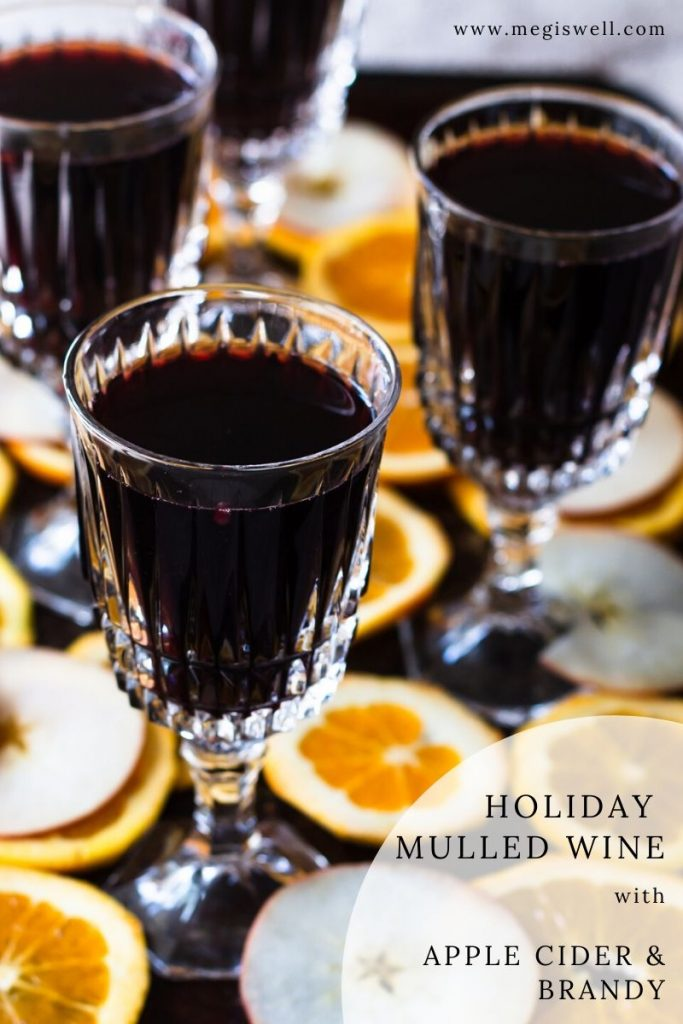 This Holiday Mulled Wine with Apple Cider and Brandy can be made on the stovetop or slow cooker and is perfect for holiday entertaining. | crockpot | #christmas #thanksgiving | www.megiswell.com