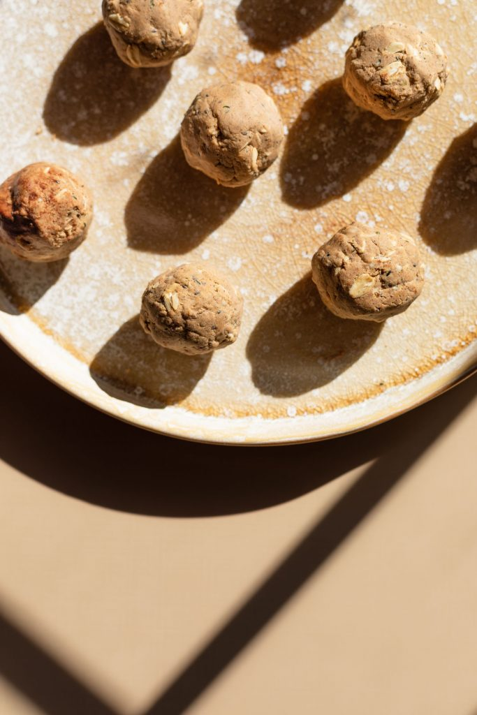 Overhead shot of no bake peanut butter protein balls on a ceramic platter.