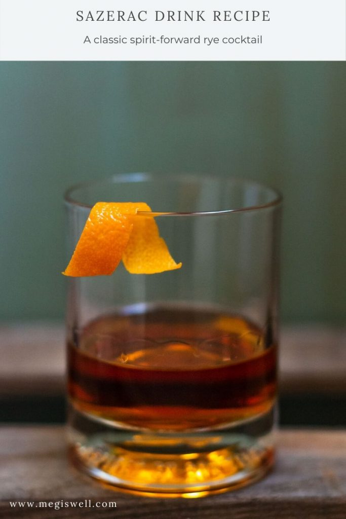 This Sazerac drink recipe is a stiff one composed of an absinthe rinse, water, demerara sugar, Peychaud's bitters, rye, cognac, and orange peel. It's heady, aromatic, and has layers of flavors pretty complex for such a simple drink. | New Orleans | Spirit Forward Cocktail | Classic Drink Recipe | www.megiswell.com