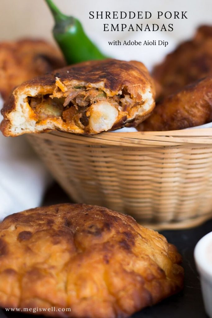 Use your leftover pulled pork for these Shredded Pork Empanadas. Fire roasted tomatoes and chilies in adobo sauce create a fiery sauce and poblano peppers add smoky flavor to the filling. Dip them in a delicious Adobo Aioli Dip made from the sauce. | Pulled Pork Recipes #leftovers #leftoverrecipes | www.megiswell.com
