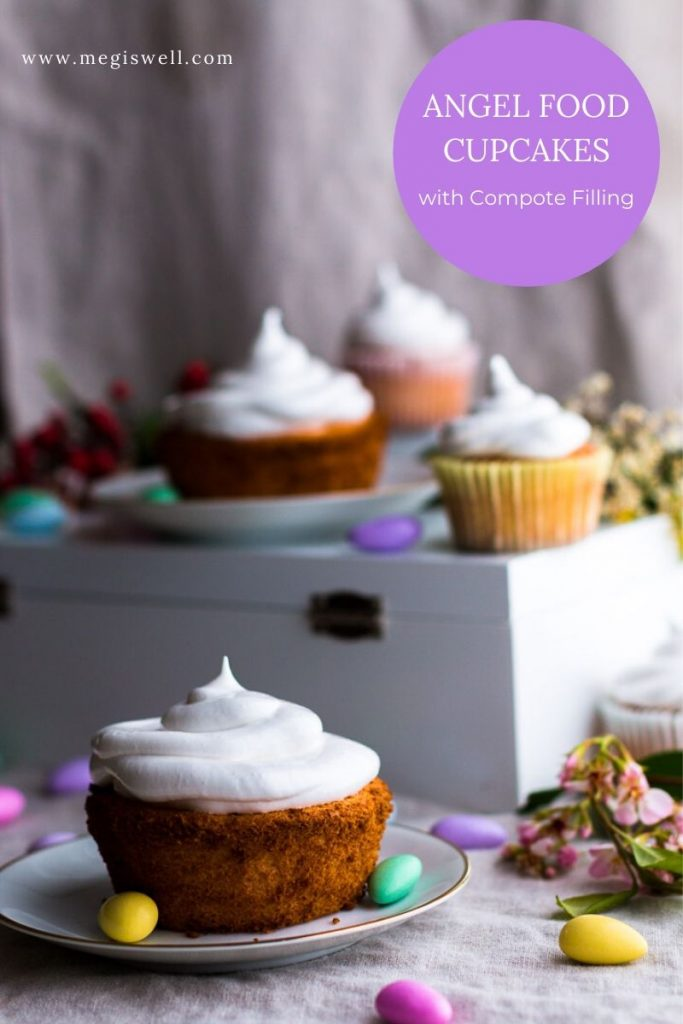 Homemade angel food cupcakes filled with strawberry limoncello compote & covered in 7-minute frosting are airy dreamy bites of heaven. | Made from Scratch | Easter Dessert Cupcakes | #angelfoodcake | www.megiswell.com