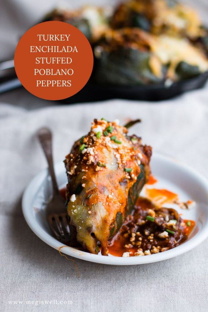 Use your leftover turkey (or chicken) in these Turkey Enchilada Stuffed Poblano Peppers. Turkey and brown rice are smothered in a homemade red enchilada sauce and topped with melty cheese. | Pantry Recipes | #leftovers #leftoverrecipes | www.megiswell.com