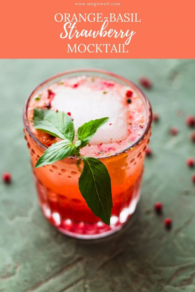 This Orange-Basil Strawberry Mocktail contains the sweet tartness of fresh strawberries, fresh squeezed orange juice, a warm peppery kick, and a refreshing basil aroma. You'll fit right into any party sipping on this! Non Alcoholic | Summer Drinks | Shrub Mocktail | #mocktail #mocktailrecipe | www.megiswell.com