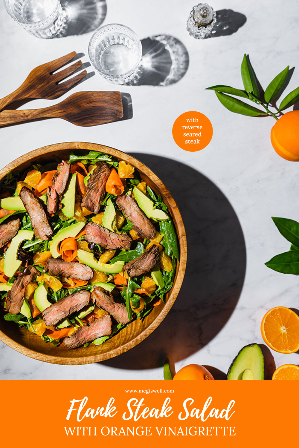 This delicious Flank Steak Salad with Orange Vinaigrette contains perfectly reverse seared flank steak (no grill required), fresh winter oranges, Thai basil, arugula, peeled carrots, and avocado. | recipe with steak | steak marinade recipe | easy flank steak recipe | flank steak dinner | healthy | how to cook flank steak | oven flank steak | homemade salad | salad recipe | www.megiswell.com